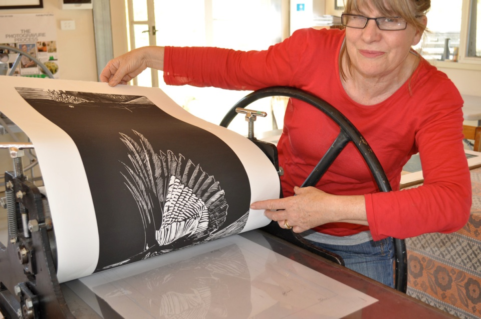 Gillian Kline in Freestone Press pulling a linocut